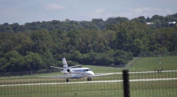 large plane landing at Lunken Airport