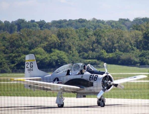 Lunken Airport runway with open cockpit and propeller plane