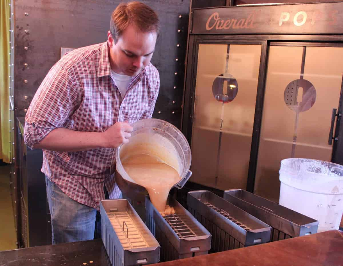 Pouring salted caramel popsicles at the Overall Company in Opelika Arkansas