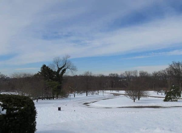 Ault Park in the snow with blue sky