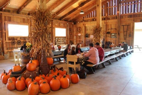Tables in the barn at Bonnybrook Farms