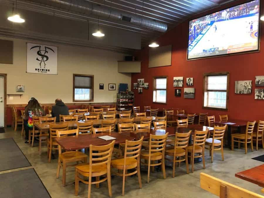 Taproom with large TV at Sons of Toil