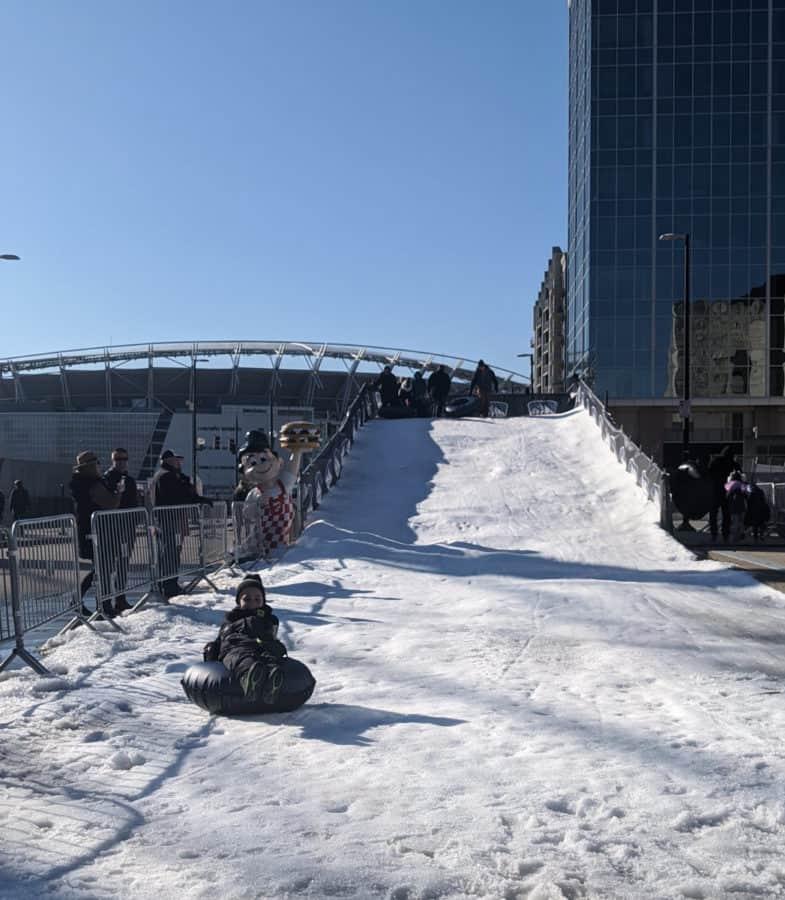 Sledding at Snow at the Banks