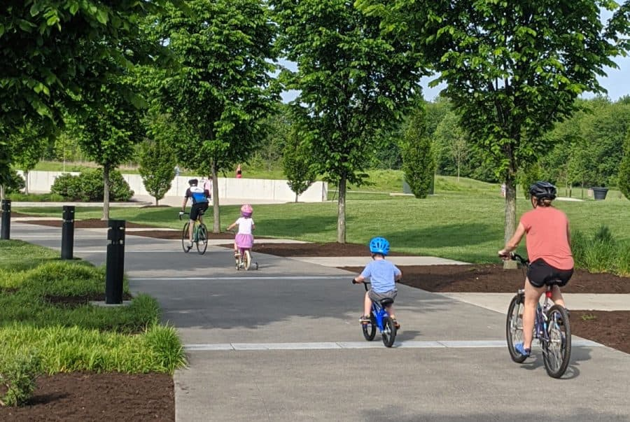 family biking on the trail at Summit Park