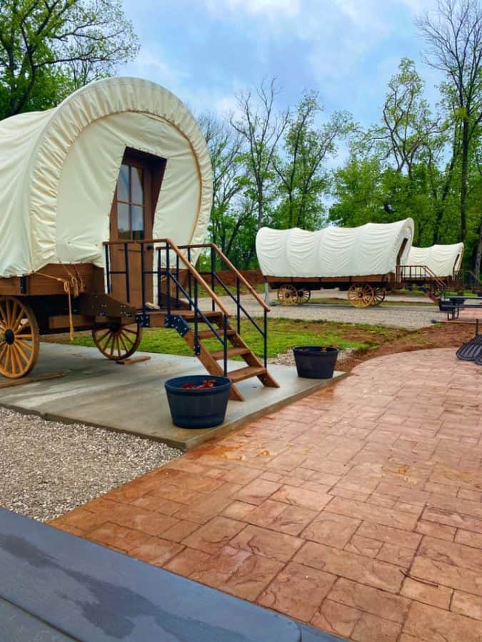 a row of covered wagons for rent at the Horse Cave KOA in Kentucky