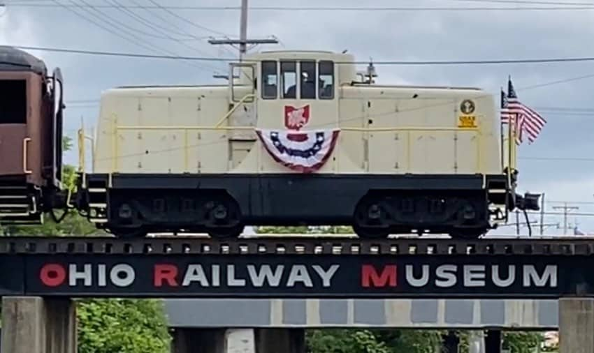 an Ohio Railway Museum train car on bridge