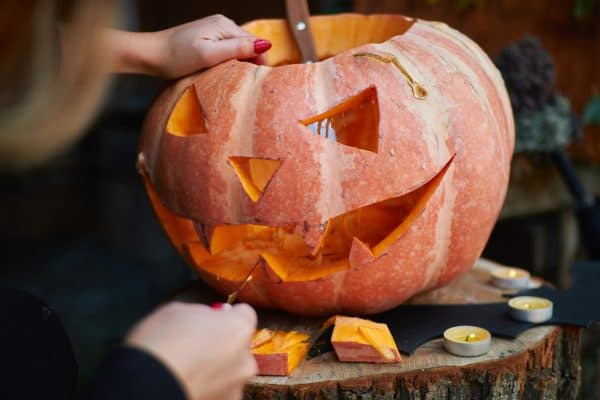 Carving pumpkins in the fall