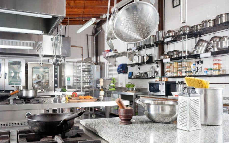 a commercial kitchen with lots of tools and appliances