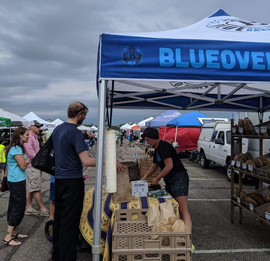 Buying Blue Oven bread at the Blue Ash Farmers Market
