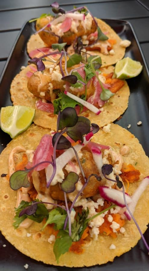 Three fish tacos on a plate at Sammy's Craft Burgers' patio