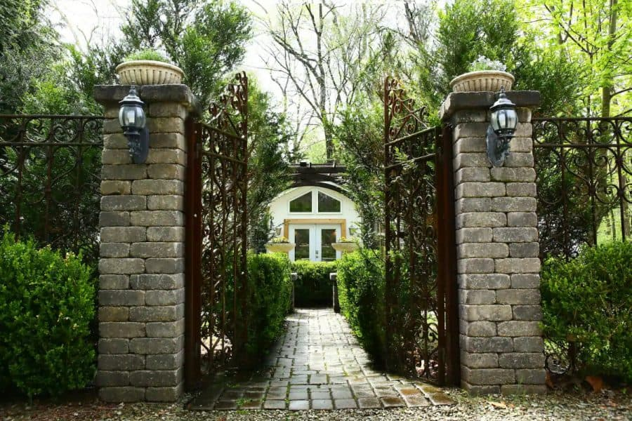 Iron gates leading to an Airbnb garden villa